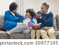Grandparents and grandson reading book together 30977105
