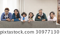 Portrait of smiling multi-generation family on living room sofa 30977130