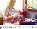 Senior adult woman has knitting activity 30981377