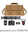 camera bag with photographer gear 30988700