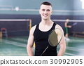 Sportman is playing tennis 30992905
