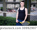 Sportman is playing tennis 30992907