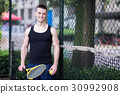 Sportman is playing tennis 30992908