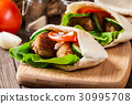 Pita bread with falafel and fresh vegetables 30995708