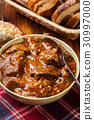 Beef stew served with crusty bread 30997000