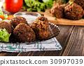 Chickpea falafel balls with vegetables 30997039