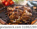 Grilling chicken wings on barbecue grill 31002289