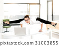 Happy female athlete working in office 31003855