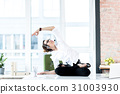 Serious woman making yoga in office 31003930