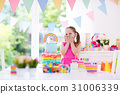Kids birthday party. Little girl with cake. 31006339