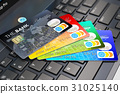 Credit cards on laptop keyboard 31025140