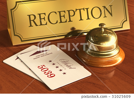 Service bell and cardkeys on hotel reception desk 31025609