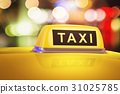 Yellow taxi sign on car 31025785