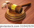 Wooden gavel and eyeglasses on table 31042029