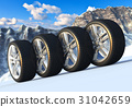 Set of car wheels in snowy mountains 31042659