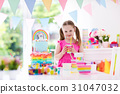 Kids birthday party. Little girl with cake. 31047032