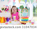 Kids birthday party. Little girl with cake. 31047034