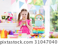 Kids birthday party. Little girl with cake. 31047040