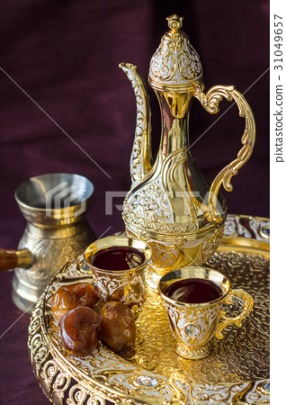Traditional golden Arabic coffee set with dallah 31049657