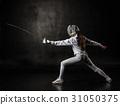 Female fencer isolated on black background 31050375