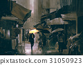 man with glowing yellow umbrella walking in city 31050923