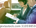 Business people meeting and discussion on backseat of the car 31059859