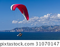 Paragliding in blue cloudy sky 31070147