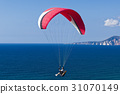 Paragliding in blue cloudy sky 31070149