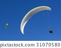 Paragliding in blue sky 31070580