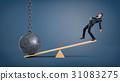 An unbalanced businessman standing on a wooden 31083275