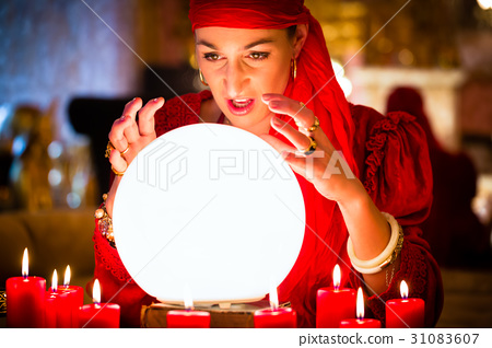 Fortuneteller at Seance with Crystal ball 31083607