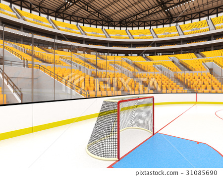 Large modern ice hockey arena with yellow seats 31085690