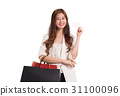 Woman holding shopping bag and credit card 31100096