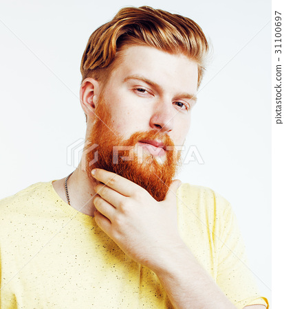 portrait of young bearded hipster guy smiling on 31100697