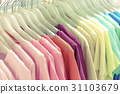 Colorful t-shirt on hangers 31103679