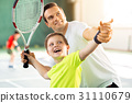 Happy child playing sport game with his parent 31110679