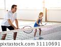 Joyful parent playing tennis with his kid 31110691