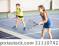 Happy children playing sport game on court 31110742