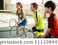 Happy girl and boys playing tennis 31110844