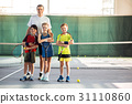 Excited kids and couch having fun on tennis court 31110860