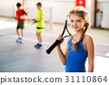 Excited kid playing tennis on playground 31110864