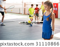 Happy female kid having fun with sports equipment 31110866