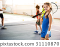 Happy child enjoying tennis game with her group 31110870