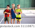 Girl and boys playing tennis with enjoyment 31110871