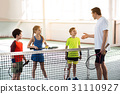 Happy kids learning rules of tennis game 31110927