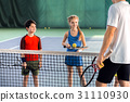 Male tennis trainer teaching children 31110930