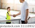 Proud tennis couch praising his pupil 31110932