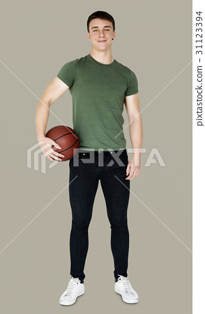 Young adult muscular man holding basketball 31123394