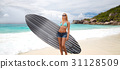 smiling young woman with surfboard on summer beach 31128509