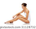 woman with safety razor shaving legs 31128732